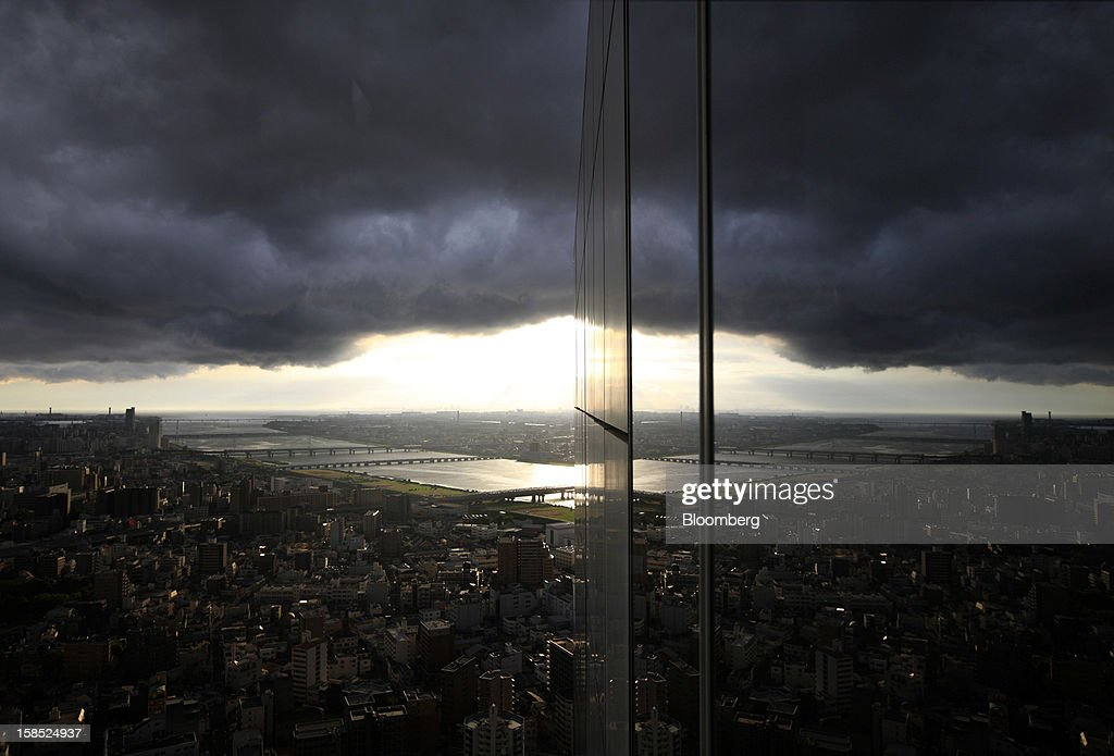 Bloomberg's Best Photos 2012: The Global Landscape. The year 2012 challenged Bloomberg photographers with a variety of global economic stories, from Japan Airlines' trading debut to Swiss banks losing employees, from Brazil's Petrobras reporting its first quarterly loss in 13 years to the grand opening of the 675,000-square-foot Barclay's Center in Brooklyn, New York. To tell these stories accurately in pictures more often than not required a bird's-eye view, see their work here in Global Landscape. 'BEST PHOTOS OF 2012' (): The Yodogawa river and commercial and residential buildings are reflected on the side of a building in Osaka, Japan, on Friday, Aug. 31, 2012. Japanese companies' capital spending report released on Sept. 3 may lead the government to revise down an estimate that the economy grew an annualized 1.4 percent in April-through-June, already weaker than the 5.5 percent gain in the first quarter, RBS Securities Japan Ltd. said. Photographer: Tomohiro Ohsumi/Bloomberg via Getty Images
