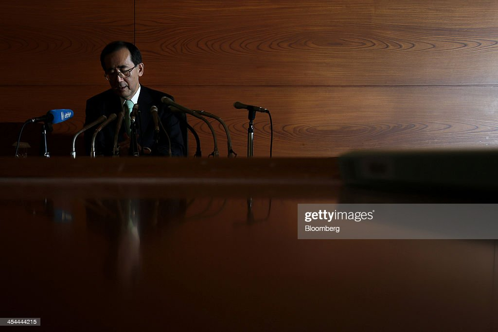 Bloomberg's Best Photos 2013: <a gi-track='captionPersonalityLinkClicked' href=/galleries/search?phrase=Masaaki+Shirakawa&family=editorial&specificpeople=5103203 ng-click='$event.stopPropagation()'>Masaaki Shirakawa</a>, outgoing governor of the Bank of Japan, attends a news conference in this photograph lit with an external flash unit at the central bank's headquarters in Tokyo, Japan, on Tuesday, March 19, 2013. In his final news conference today, Shirakawa warned that merely expanding the monetary base won't end deflation and said it's dangerous for central banks to try to control market movements. Photographer: Kiyoshi Ota/Bloomberg via Getty Images