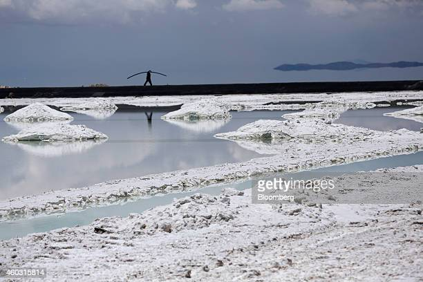 Bloomberg's Best Photos 2014 A worker walks near an evaporation pool where lithium bicarbonate is isolated from salt brine during the process of...