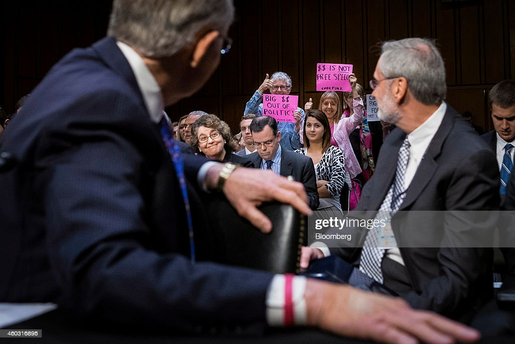 Bloomberg's Best Photos 2014 Code Pink activists hold up signs in support of a proposed constitutional amendment on campaign finance during a Senate...