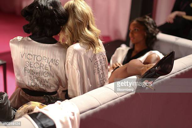 Bloomberg's Best Photos 2014 Jasmine Tookes a Victoria's Secret angel far right wears a dressing gown produced by Victoria's Secret as she rests on a...