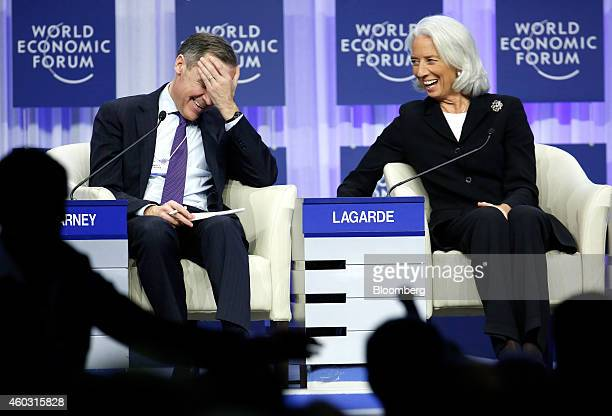 Bloomberg's Best Photos 2014 Mark Carney governor of the Bank of England left reacts as he speaks with Christine Lagarde managing director of the...