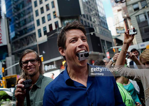 Bloomberg's Best Photos 2014 Nick Woodman founder and chief executive officer of GoPro Inc stands for a photograph with a GoPro Hero 3 camera in his...