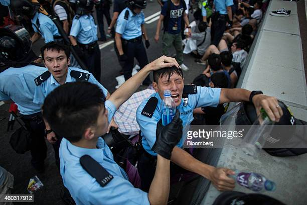 Bloomberg's Best Photos 2014 Police clash with demonstrators during a protest near the central government offices in Hong Kong China on Sunday Sept...
