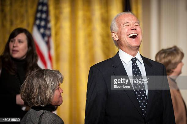 Bloomberg's Best Photos 2014 US Vice President Joe Biden right laughs during an event for the Council on Women and Girls in the East Room of the...