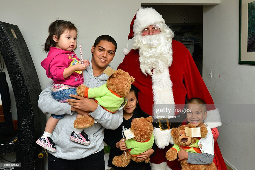 Bloomingdales and the Costa Mesa Fire Department team up to deliver teddy bears and gifts to underpriviledged families for the 12th Annual CMFD Santa Letters on December 22, 2012 in Costa Mesa, California.
