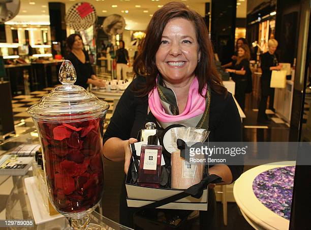 Bloomingdale's Costa Mesa employee displays a gift box at Ready Set Pink Event At Bloomingdale's Costa Mesa on October 20 2011 in Costa Mesa...