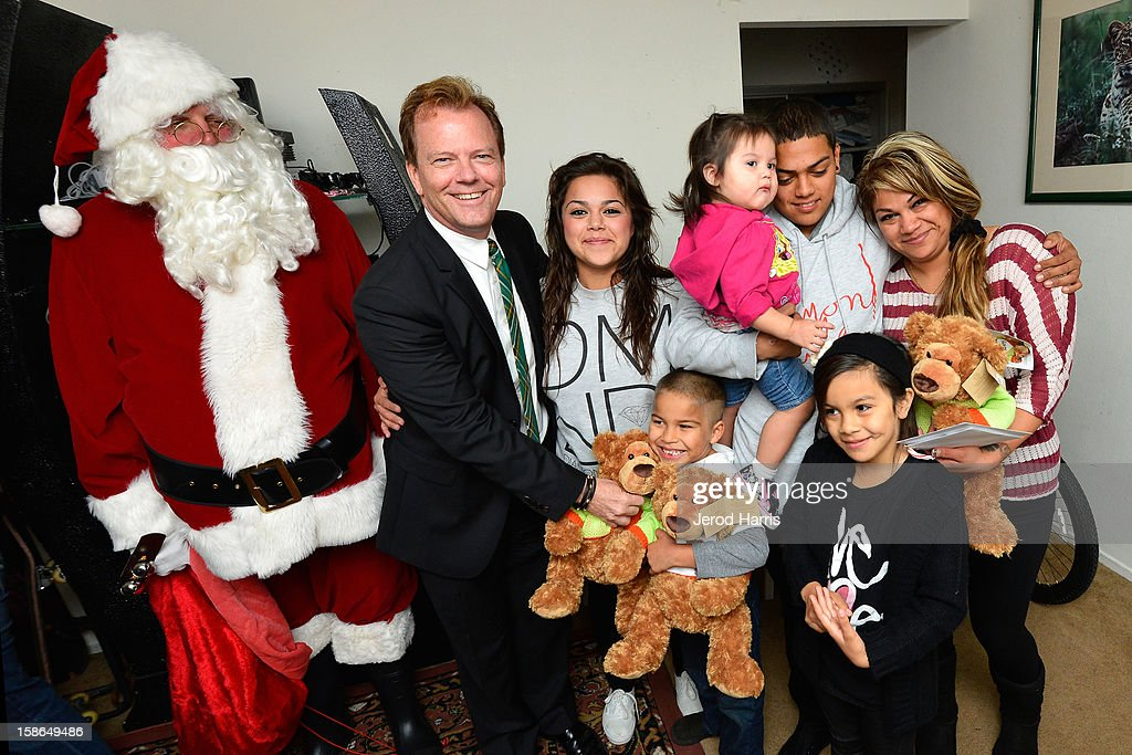 Bloomingdales South Coast Plaza General Manager Jim Murphy deliveres gifts to an underpriviledged family for the 12th Annual Costa Mesa Fire Department Santa Letters on December 22, 2012 in Costa Mesa, California.