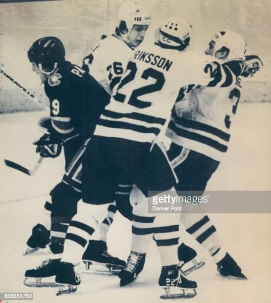 Bloomington Minn Nov 6ERPardon MeColorado Rockies pays little heed to the threesome of Minnesota North Stars Fred Barrett Roland Ericksson and Nick...