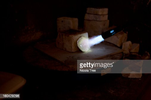 blow torch heating up a piece of silver : Stock Photo