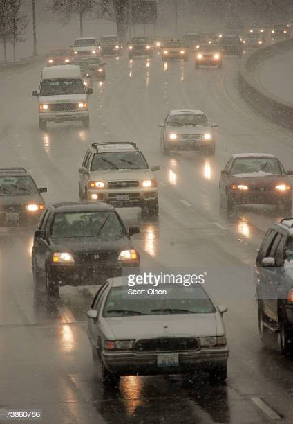 Blowing snow and sleet mixed with rain slows traffic on Lake Shore Drive April 11 2007 in Chicago Illinois The weather caused traffic and flight...