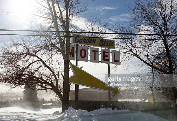 Blowing snow shrouds a motel sign after a major blizzard on December 27 2010 in Hillside New Jersey A massive snow storm with gusty winds and...
