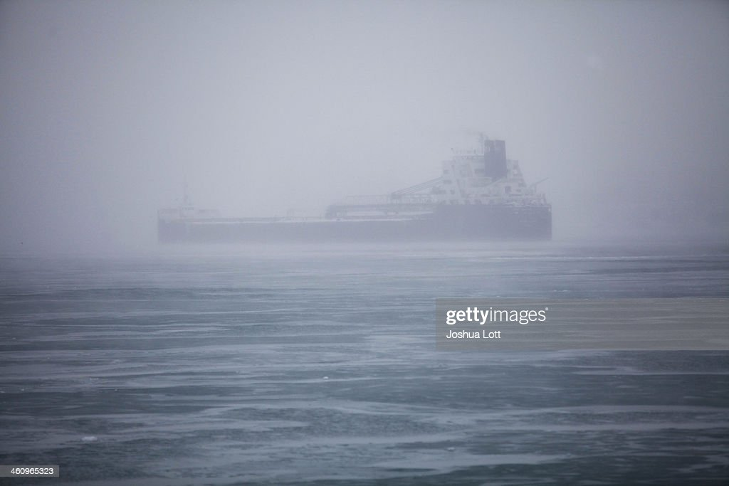 Blowing snow surrounds a transport ship along the Detroit River as the area deals with record breaking freezing weather January 6, 2014 in Detroit, Michigan. Michigan and most of the Midwest received their first major snow storm of 2014 last week and subzero temperatures are expected most of this week with wind-chill driving temperatures down to 50-70 degrees below zero. A 'polar vortex' weather pattern is bringing some of the coldest weather the U.S. has had in almost 20 years.