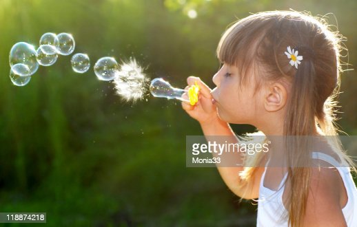 Blowing soap bubbles : Stock Photo