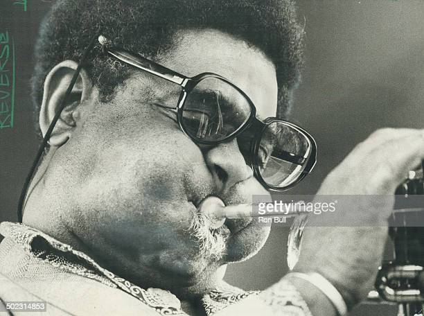 Blowing some hot Jazz trumpet player Dizzy Gillespie thrilled the crowd Saturday and Sunday at Varsity Stadium during twoday festival The fans...