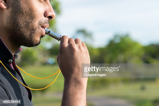 Blowing whistle : Stock Photo