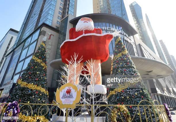 A blowup Santa Claus doll that imitates the famous Marilyn Monroe pose is seen before a shopping mall in Taiyuan central China's Henan province on...
