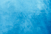 Rough grunge painted abstract blue art background