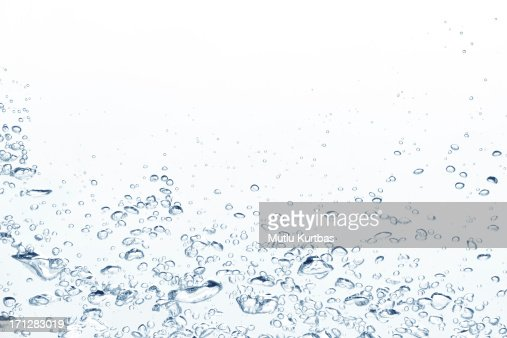 Blue air bubbles rising in clear fresh water
