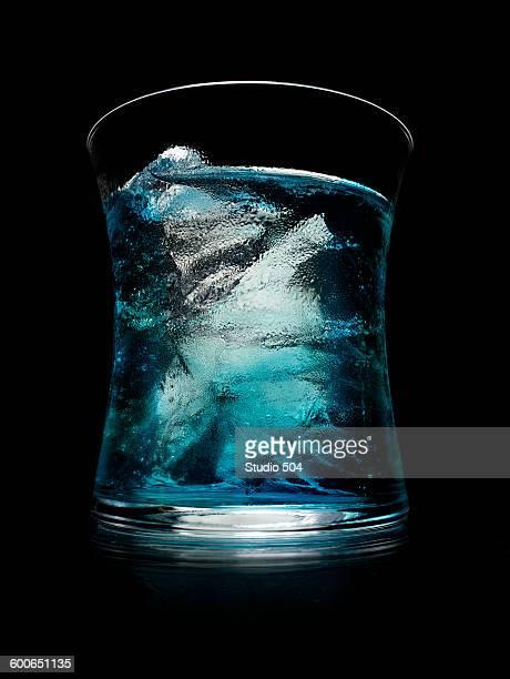 Blue alcohol cocktail on black