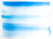 Blue and aqua watercolor waves on watercolor texture paper