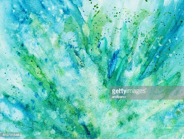 Blue and green hues of paint splattered background
