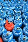 Blue and orange LPG or propane tank