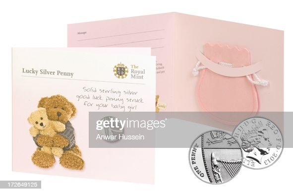 Blue and pink pouches inside a card decorated with teddies and the message 'Solid sterling silver good luck penny' are to be presented by the Royal Mint to babies born on the same day as the first child of the Duke and Duchess of Cambridge on July 4, 2013 in Pontyclun, Wales.