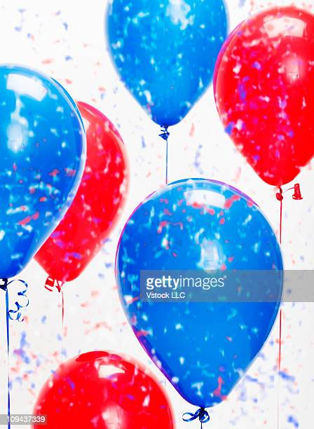 Blue and red political balloons with confetti