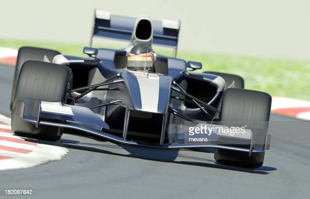 A blue and silver race car on a track