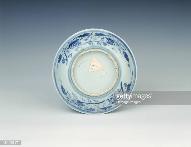 Blue and white dish Ming dynasty China c1500 Small dish with everted rim decorated in the centre with a spotted deer and crane among pine prunus and...