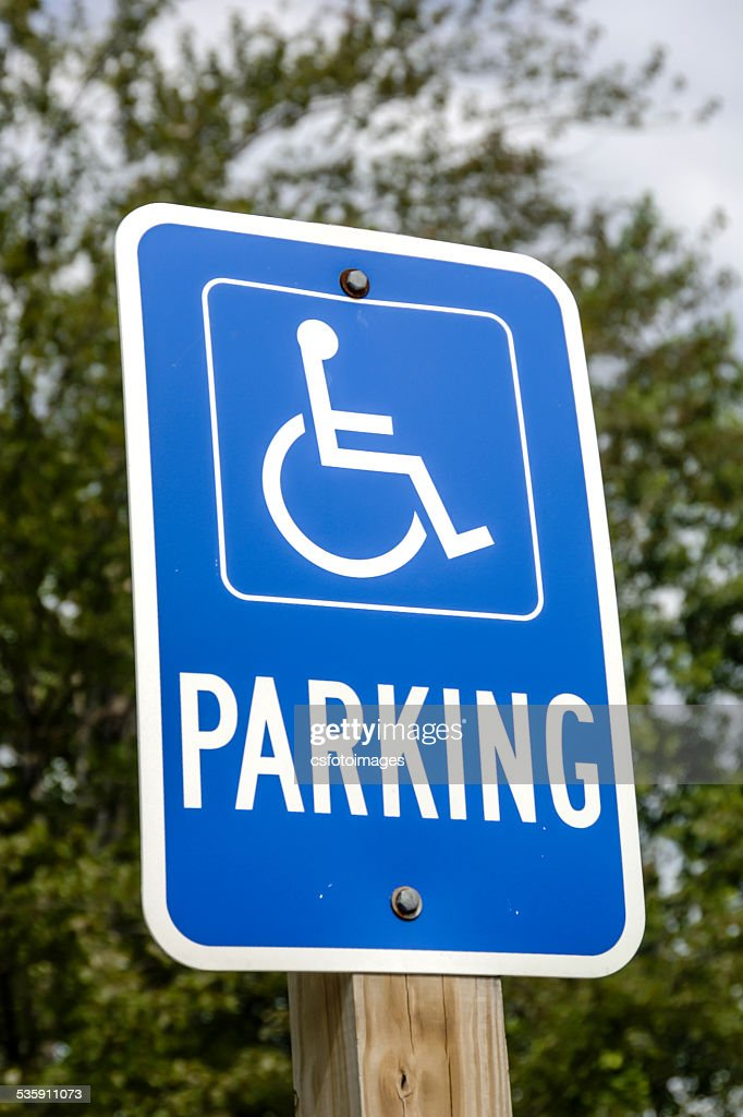 Blue and white Handicapped Parking sign : Stock Photo