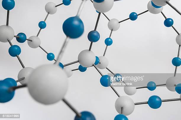 Blue and white molecular structure against white background
