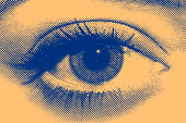 Blue and yellow halftone eye of a beautiful girl.