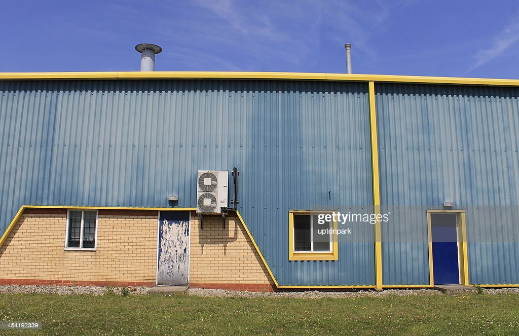 Blue and yellow warehouse : Stock Photo
