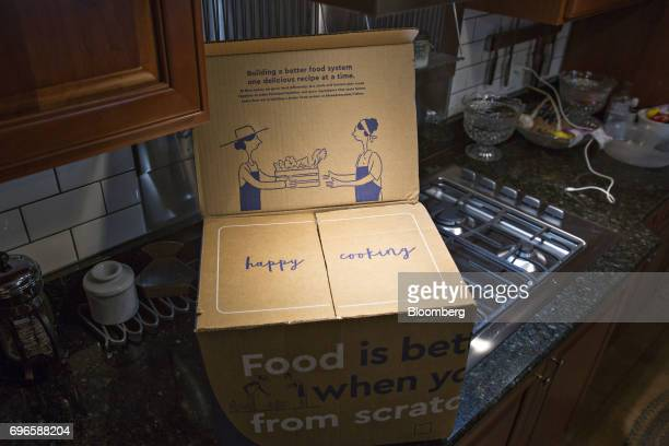A Blue Apron Holdings Inc mealkit delivery package is arranged for a photograph in Tiskilwa Illinois US on Wednesday June 14 2017 Blue Apron Holdings...
