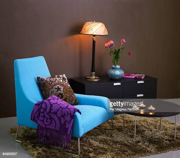 A blue armchair in a living room Sweden.