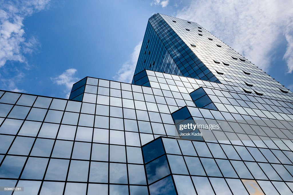 Blue background of glass high rise building : Stock Photo