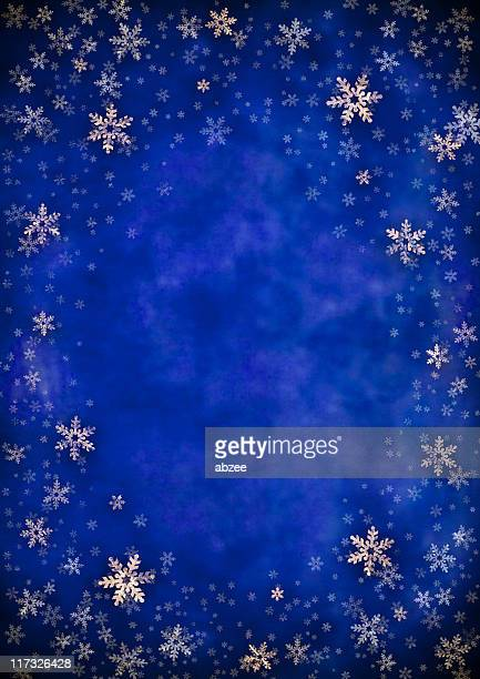 Blue background vignetted with gold foil snowflakes