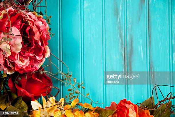 Blue background with fall flowers