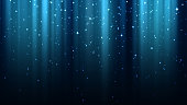 Blue background with rays of light, sparkles, northern lights, night starry sky