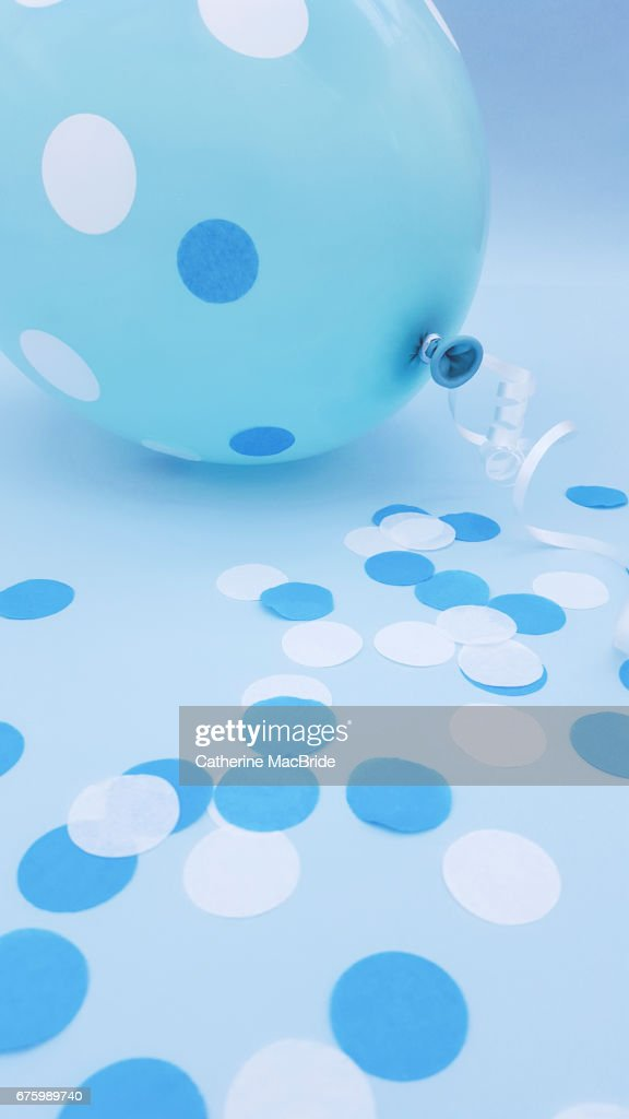 Blue Balloon and Confetti : Stock Photo