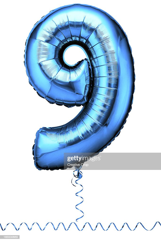 Blue balloon in the shape of a number nine