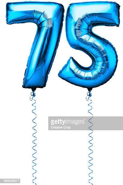 Blue balloons in the shape of a number 75
