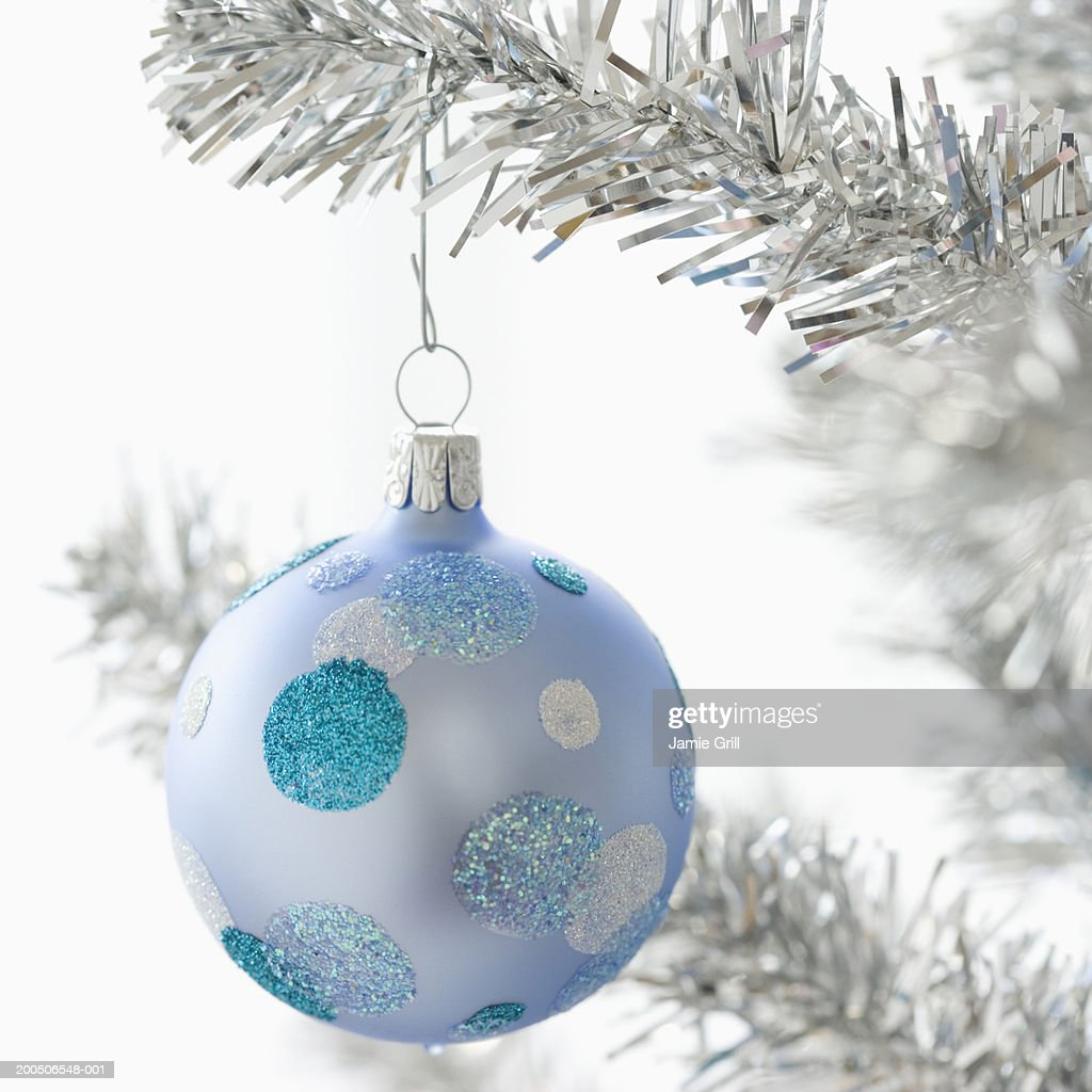 Blue bauble on christmas tree, close-up : Stock Photo