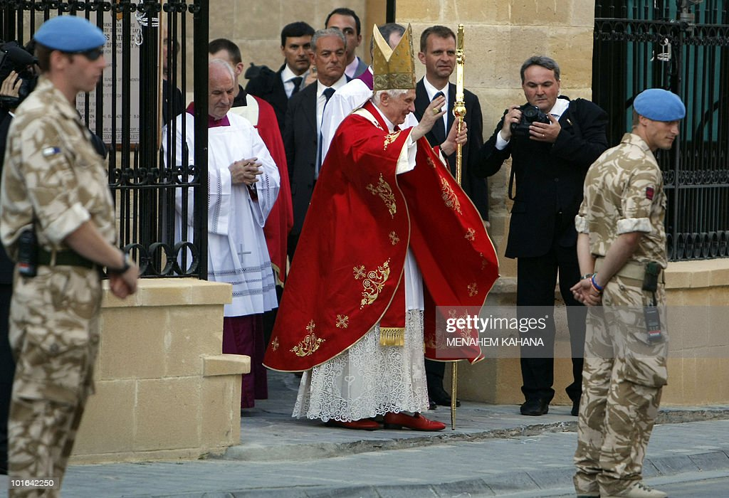 UN blue beret peacekeepers stand guard as Pope Benedict XVI leaves Nicosia's Latin Church of the Holy Cross in the divided capital of Cyprus after celebrating mass on June 5, 2010, on the second day of his visit to the mainly Greek Orthodox east Mediterranean island.