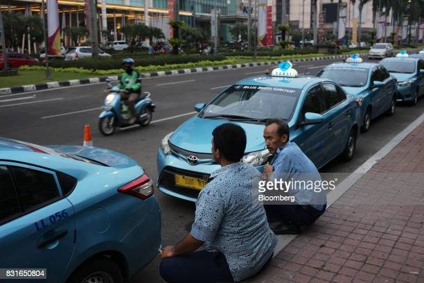 PT Blue Bird taxi drivers wait for fares in Jakarta Indonesia on Sunday Aug 13 2017 President Joko Widodo is seeking hundreds of billions of dollars...