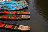 Blue boats and wooden punts