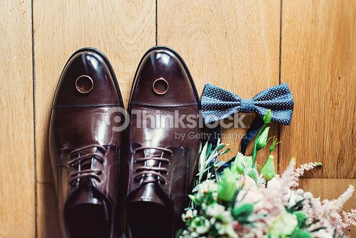 605dc7f2a4f0 blue bow tie, leather shoes and wedding rings. Grooms wedding morning.  Close up