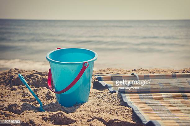 Blue bucket toy on the beach